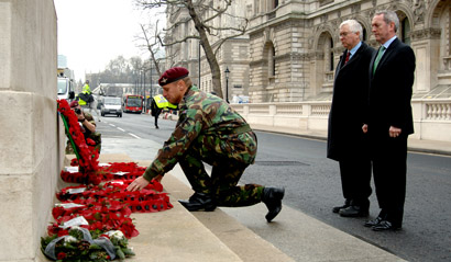 Warrant Officer Class 1 (Regimental Sergeant Major) Tony Hobbins lays a wreath at the Cenotaph accompanied by Rt Hon John Hutton (right), Secretary of State for Defence, and Bob Russell MP for Colchester.