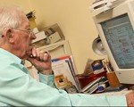 Older man using home computer