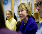Older people at meeting, focus on woman with dementia