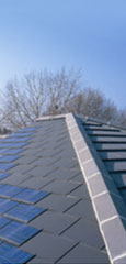Solar roof tiles on a new home in Edmonton, London: Photo courtesy of solarcentury.com