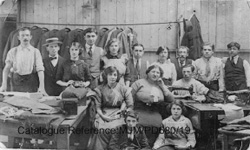 The staff of a tailor's workshop in Cheetham, Manchester.