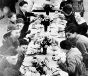 Young refugees having a meal at Dovecourt Bay Holiday Camp, 1938.
