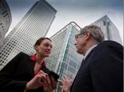 Image of a man and woman talking in business district.