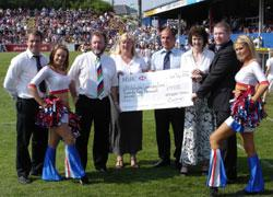 Edward Jennings presenting a cheque to the Wildcats Learning Zone