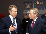 The PM chats with Secretary General, Jaap de Hoop Scheffer at a NATO summit