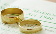 Pair of gold wedding rings on wedding register.  © Martin Poole/Getty Images