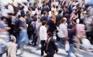 Crowd of people walking. © Ken Usami/Getty Images
