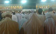 Pilgrims praying at the Holy Kaabah in the Grand Mosque, Makkah.