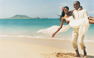 Newly wed couple on beach. © Digital vision/Getty Images