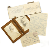 Shrapnel damaged wallet and pocket book belonging to Lieutenant Robert Stewart Smylie