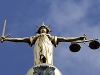 The Statue of Justice on top of the Old Bailey in London; image copyright: Reuters