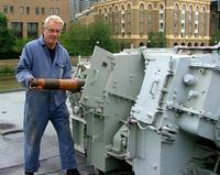 Mr Peter Motton working on the shell hoist, HMS Belfast