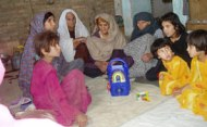 Afghan listeners to the radio soap opera 'New Home, New Life'