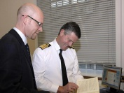 The Second Sea Lord with Matthew Sheldon RNM examining Museum artefact on visit to Museum 19th October 2006