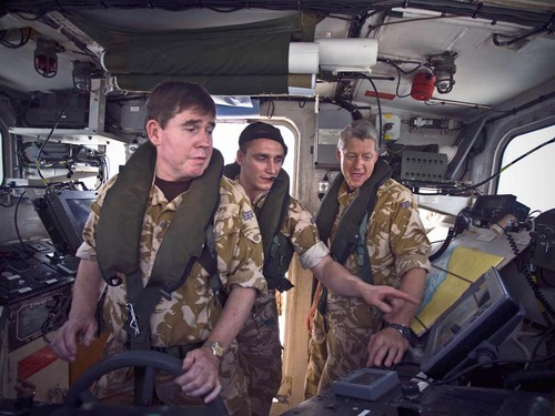 Admiral Stanhope at the helm of a Landing Platform Vehicle and Personnel
