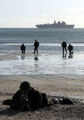 Marines undertaking final preparations before Taurus 09 deployment: Royal Marines from 40 Commando RM disembarking at Pentewan Beach, Cornwall