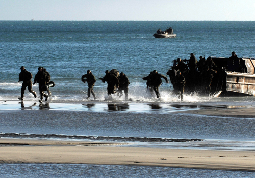 Marines undertaking final preparations before Taurus 09 deployment: Royal Marines from 40 Commando RM disembarking from an LCVP at Pentewan Beach, Cornwall