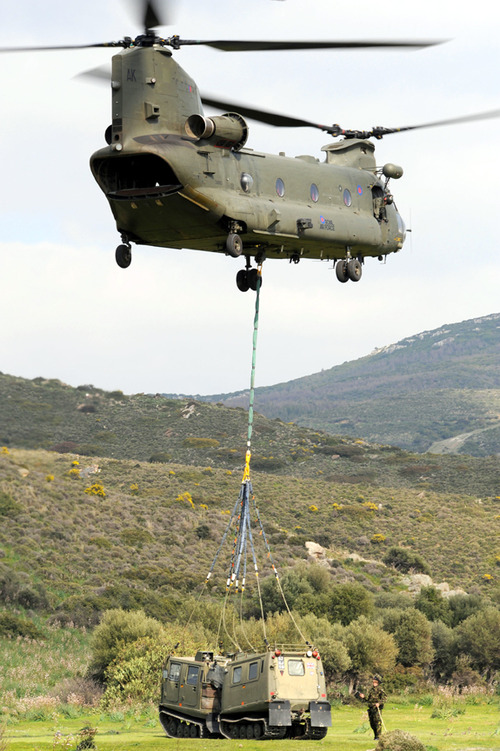 Royal Air Force chinook helicopter from 18 Squadron based onboard HMS Ocean, conducting load lifts of BV's for the troops on the ground