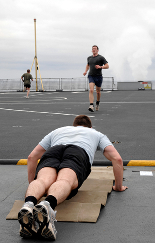 40 Commando RM, deployed on RFA Mounts Bay. The Marines from Alpha Company are conducting Circuit training on the flight deck of the ship.