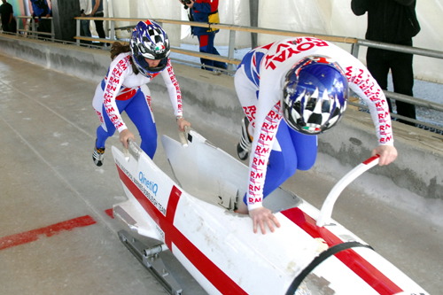 Driver Milner and Brakewomen Haynes one of the Royal Navy Bobsleigh teams, taken part in the final race