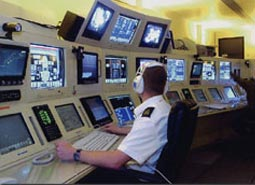 Aircrew Instructors operating the rear crew instructor console of the new Merlin simulator