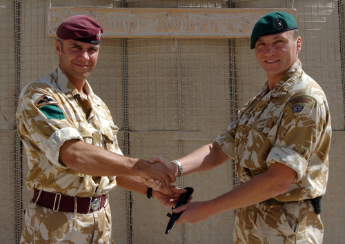 Commanding Officer's handover, from 3Para Lt Col Hew Williams and 42 Commando Lt Col Charlie Stickland handover out side Camp Roberts