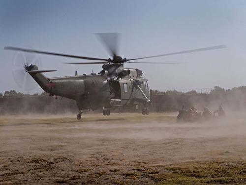 Royal Navy Seaking helicopterslanding with Marines at Forward Operating Base Sangin.