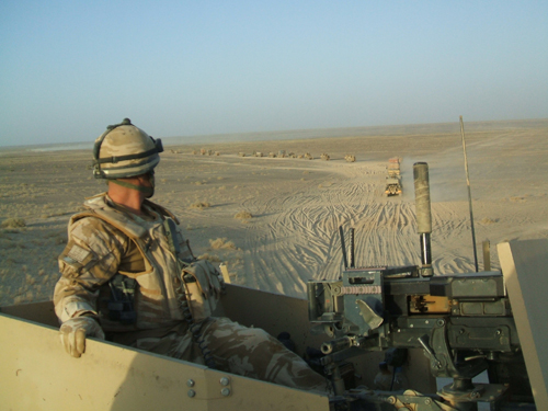 Capt Neil Swift RLC manning the Grenade Machine Gun on a Combat Logistic Patrol