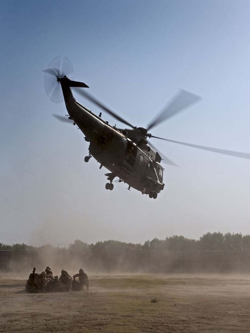 Royal Navy Seaking helicopters landing with PAX marines at Forward Operating Base Sangin.