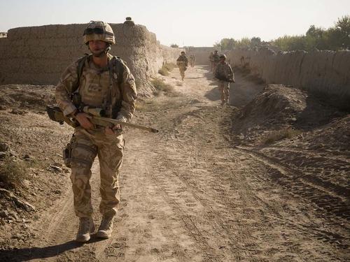 Royal Marines on patrolin Helmand province.