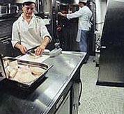 A chef preparing food onboard a nuclear submarine