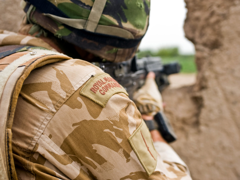 A Royal Marine from 42 Commando Group observes his arcs in between fire fights