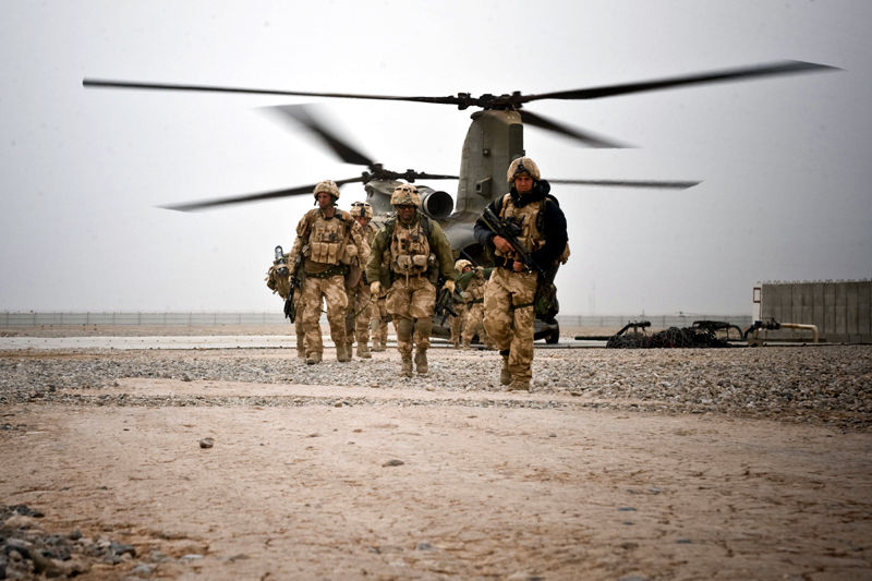 Royal Marines of 42 Commando Group exiting a Chinook helicopter
