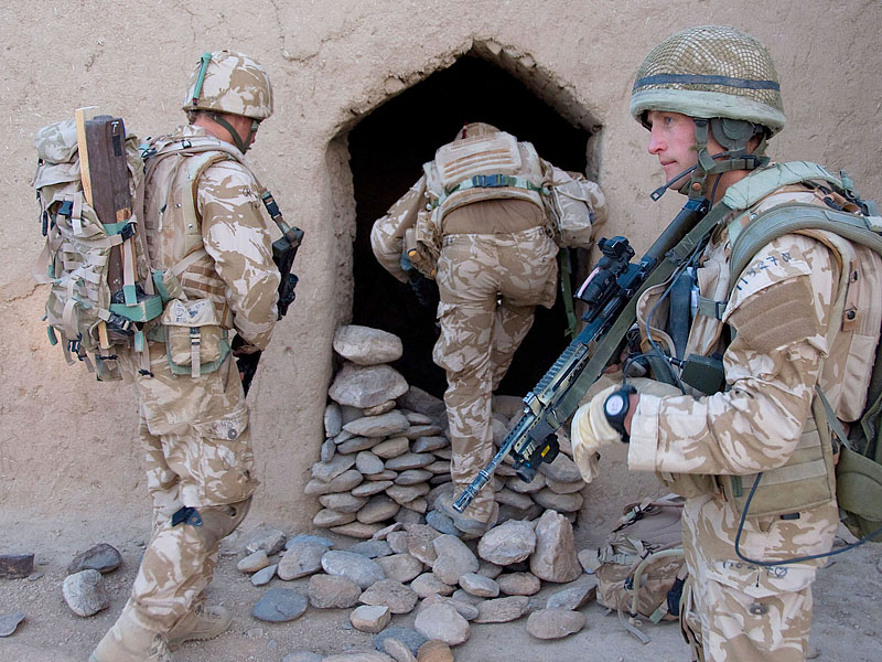 Royal Marines from X-Ray Company, 45 Commando Group, enter an abandoned compound in northern Helmand province