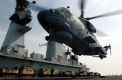 A Merlin HM1 of 814 Naval Air Squadron lands on HMS Ark Royal