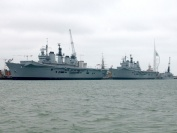 HMS Ark Royal returns to Portsmouth (October 2006) and berths behind HMS Illustrious