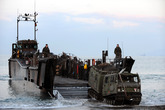 4 Assault Royal Marines based onboard HMS Bulwark landing vehicles ashore