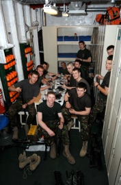 40 Commando RM, deployed on RFA Mounts Bay. The Marines are cleaning weapons in their accommodation in the embarked forces accommodation onboard the RFA ship. 24 men stay in the 'mess', or room, and with the majority of 40 Commando and their equpment onboard, space is at a premium.