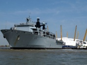 HMS Albion sailing up the River Thames past the Thames Barrier and heading towards the Millenium Dome and Canary Wharf, July 2006