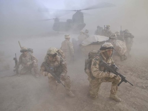 Royal Marines being picked up whilst on patrolin Helmand province.