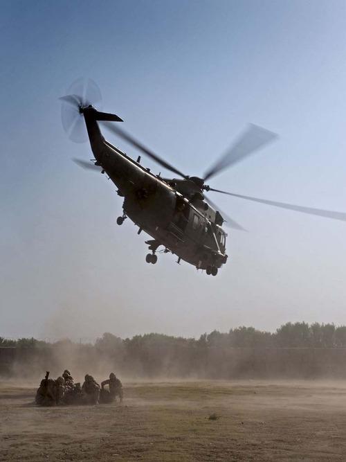 Royal Navy Seaking helicopterslanding with PAX marines at Forward Operating Base Sangin.