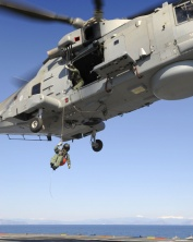 Aircrewman Being Winched From A Merlin