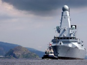 HMS Daring sails past Dumbarton Castle, under its own steam for the very first time escorted by tugs from BAE Systems Scotstoun, 18 Jul 07.