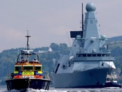 HMS Daring sails under its own steam for the very first time escorted by tugs from BAE Systems Scotstoun, 18 Jul 07.