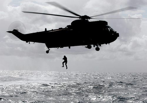 Members of the Squadron Reconnaissance Team of 539 Assault Group Royal Marines, 'Helocasting' off a Sea King in order to practice covert insertion reconnaisance methods