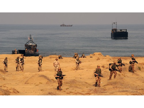 LCVPs from RFA Lyme Bay and HMS Bulwark land troops ashore