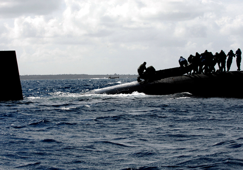 Marines are practising deploying their inflatable boats on and off Submarines