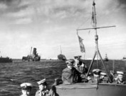 Admiral Harwood Commander in Chief Mediterranean inspects sunk Axis shipping in Benghazi Harbour