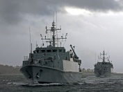 HMS Grimsby and HMS Ramsey sail into a stormy Gareloch where they will make HMNB Clyde their new home