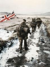 Royal Marine Commandos march towards Port Stanley